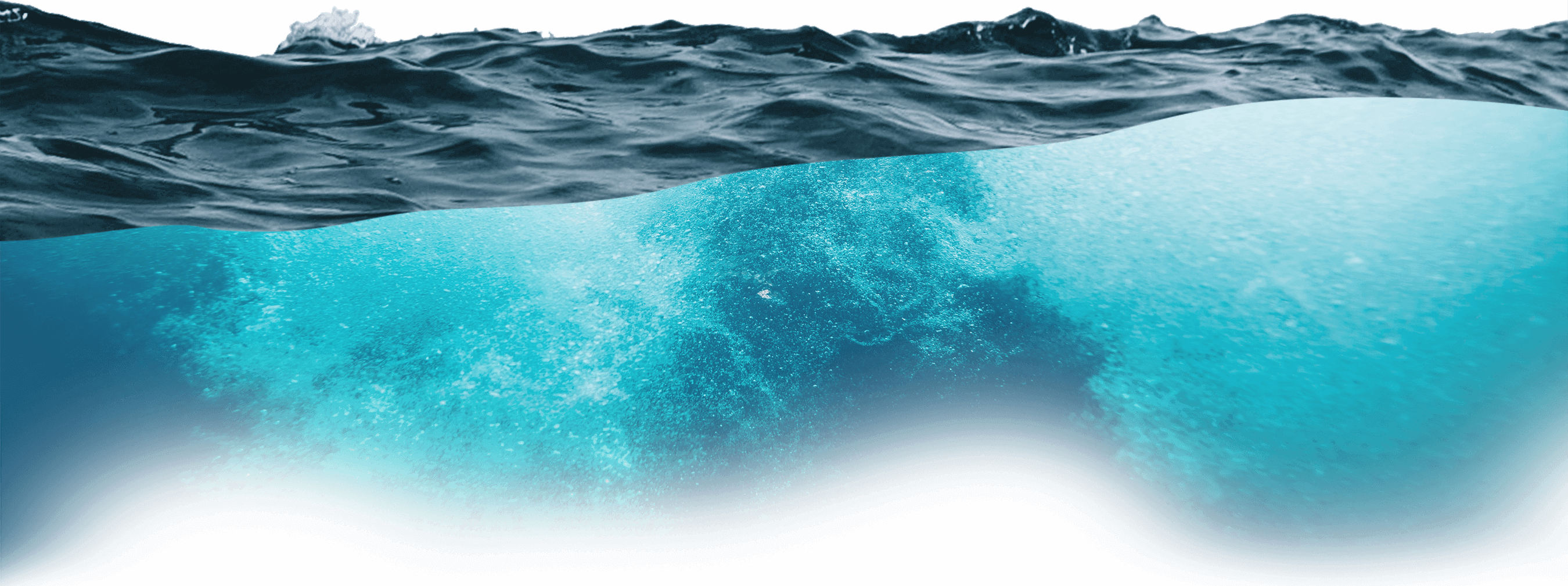 Wavy ocean surface with bubbles underwater
