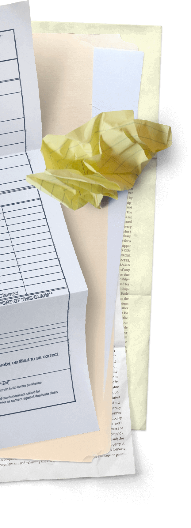 Crumpled yellow paper on top of documents
