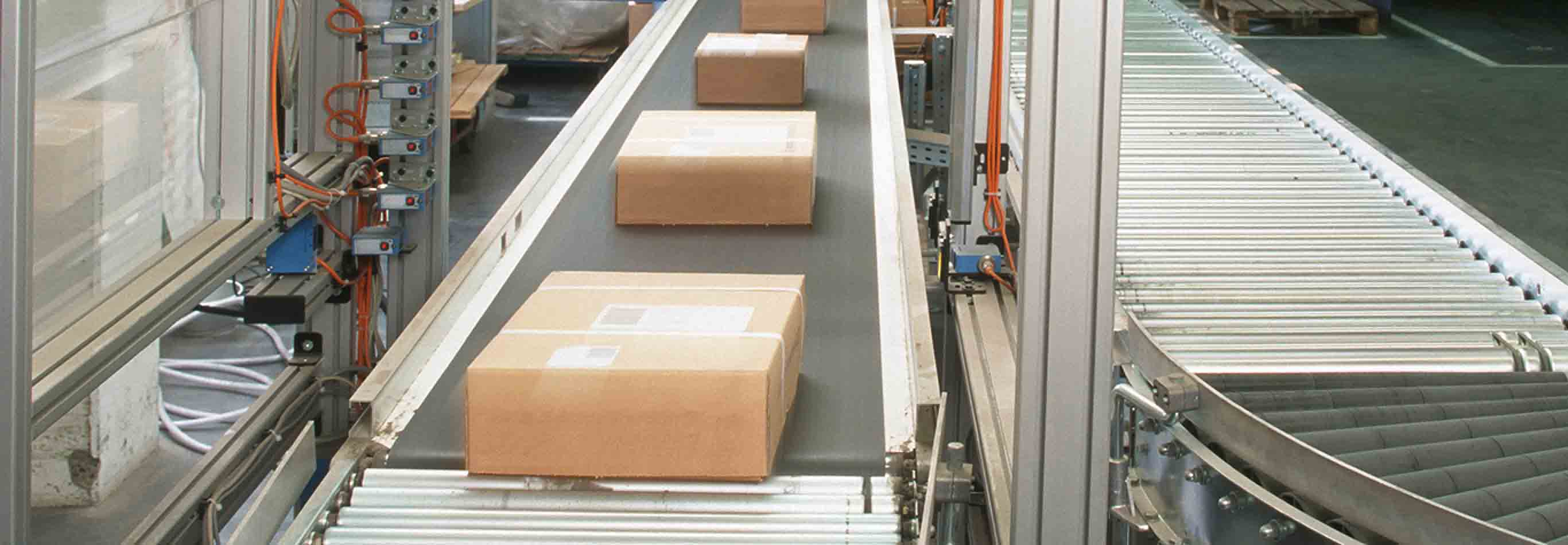 Image of packages moving on conveyor belt.