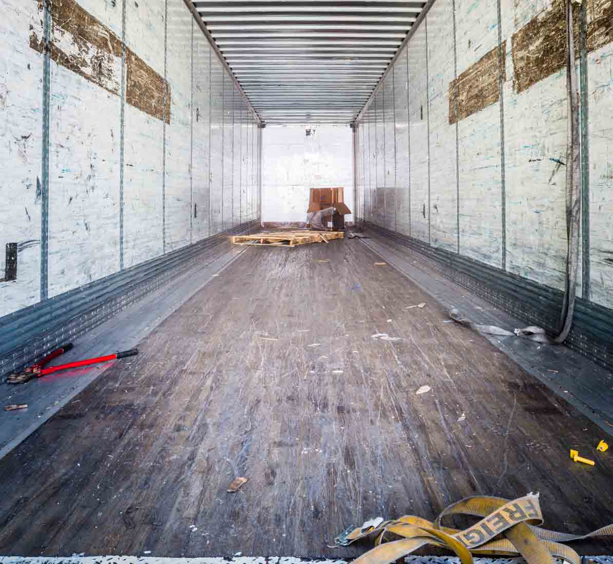 Empty freight container after delivering packages