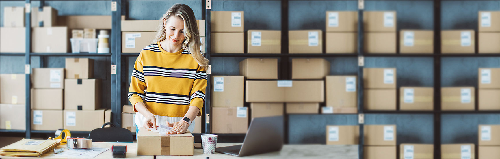 Business woman packing a shipment