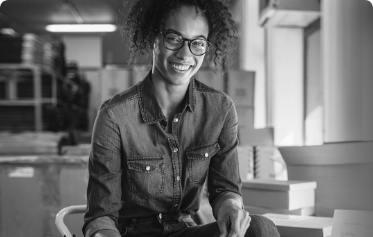 Woman with glasses smiling in a storage unit