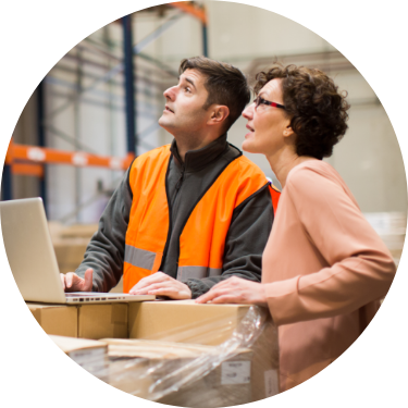Man and woman overseeing inventory in a warehouse