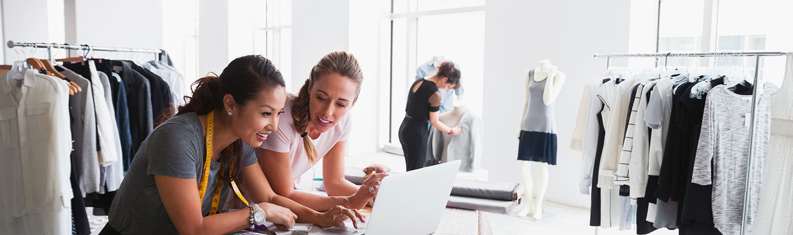 Women in a retail store checking inventory on a computer